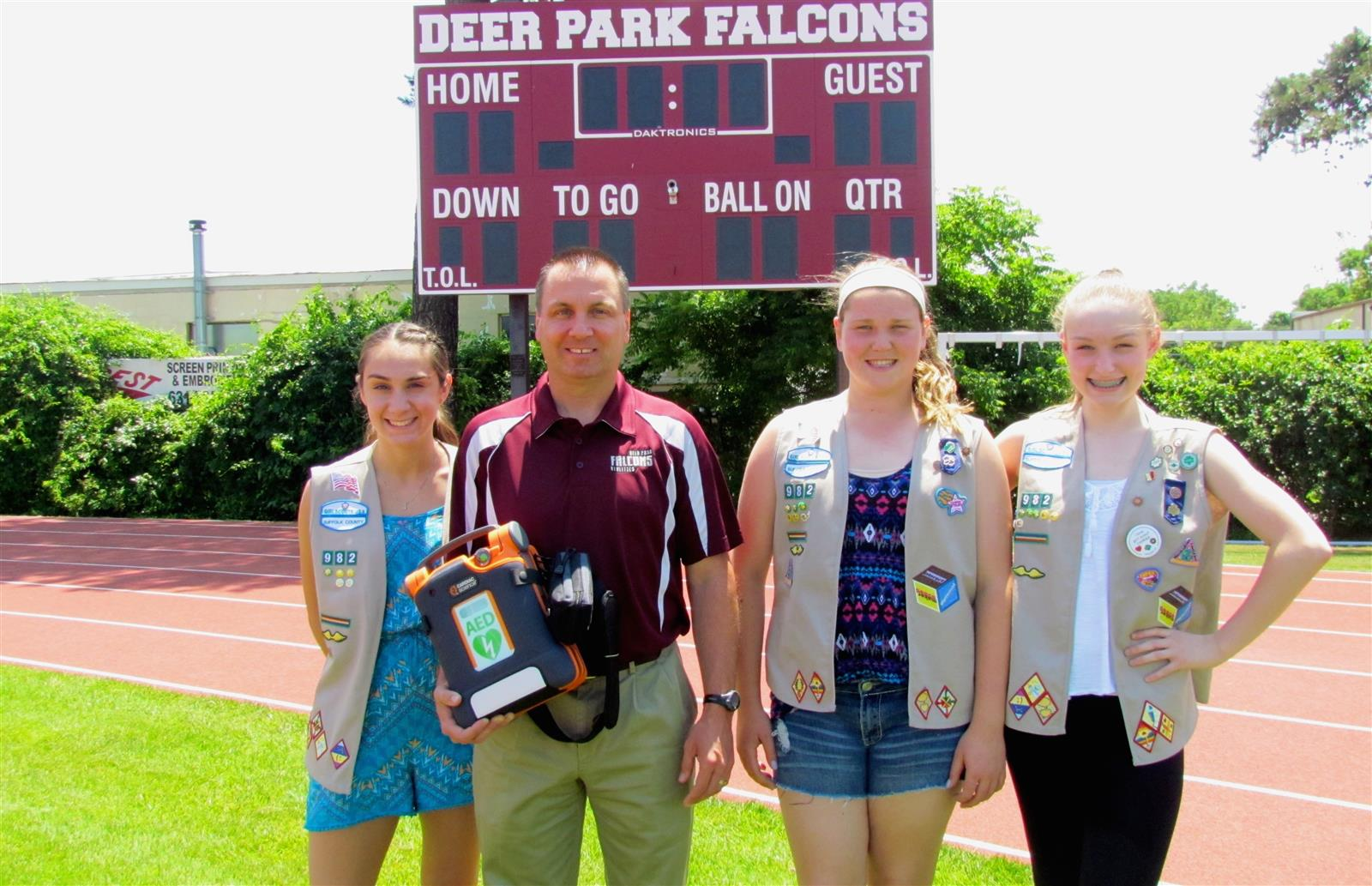 Scout Cadettes Set Up Defibrillator Donation