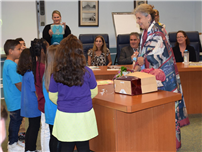 Six Second-Graders Serenade Board of Ed